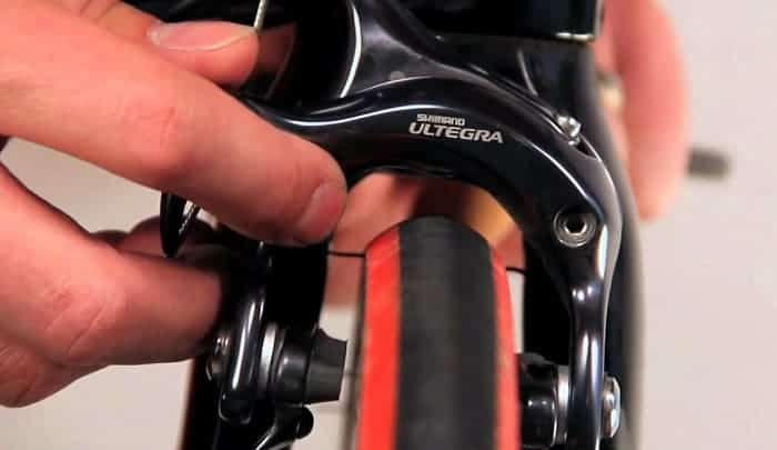 how to adjust bike brakes rubbing